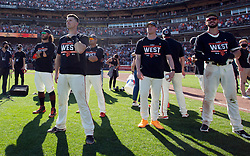 Oct 3, 2021; San Francisco, California, USA;  San Francisco Giants players and coaches celebrate their 11-4 victory over the San Diego Padres at Oracle Park. The Giants clinched the National League West Division with the win. Mandatory Credit: D. Ross Cameron-USA TODAY Sports