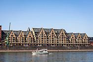 view over the river Rhine to the old storehouse in the Rheinau Harbour, Cologne, Germany.<br /> <br /> Blick ueber den Rhein zum alten Speicher, genannt Siebengebirg im Rheinauhafen, Koeln, Deutschland.