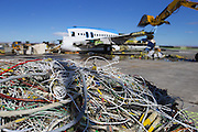 Wires from the 757 are put aside for recycling as the rest of the plane is being torn apart. <br /> <br /> Mike Siegel/The Seattle Times