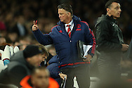 Louis van Gaal, the Manchester United Manager calls for Wayne Rooney of Manchester United (not in pic) to be subbed on. The Emirates FA cup, 6th round replay match, West Ham Utd v Manchester Utd at the Boleyn Ground, Upton Park  in London on Wednesday 13th April 2016.<br /> pic by John Patrick Fletcher, Andrew Orchard sports photography.