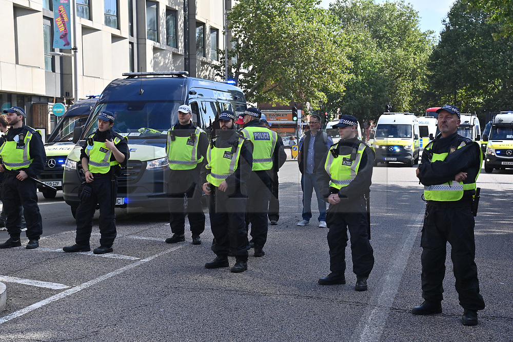 © Licensed to London News Pictures. 16/09/2021. London, UK. Police officers monitor anti Lockdown and anti Covid vaccination protesters taking part in a demonstration calling for an end to mandatory vaccination passports and the vaccination of teenagers. Photo credit: London News Pictures