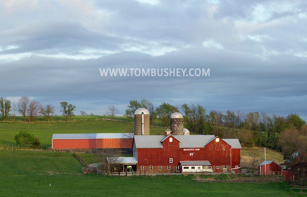Chester, New York - The setting sun shines on the barns and silos at Brookview Farm on April 12, 2012.