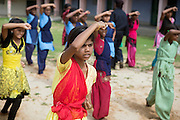 Tabasum Khatun, 14, is practising a Karate defensive move during a class in Algunda village, pop. 1000, Giridih District, rural Jharkhand, India.