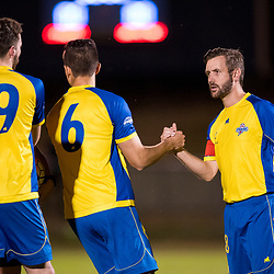 BRISBANE, AUSTRALIA - AUGUST 26: Brisbane Strikers captain Michael Angus shakes hands with his teammates before the NPL Queensland Senior Men's Semi Final match between Brisbane Strikers and Moreton Bay Jets at Perry Park on August 26, 2017 in Brisbane, Australia. (Photo by Patrick Kearney)
