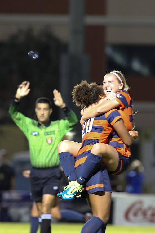 Cal State Fullerton forward Sarah Fajnor (27) embraces Cal State Fullerton forward Atlanta Primus (20) after Fajnor's goal at the Big West Semi-final in Long Beach on November 3, 2016.
