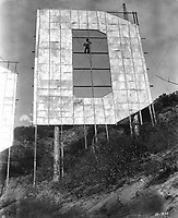 November 1923 Man standing in the letter D during construction of the Hollywoodland sign