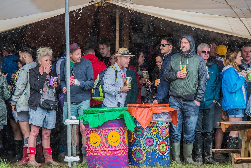 Sheltering from teh rain in a bar - The 2016 Glastonbury Festival, Worthy Farm, Glastonbury.