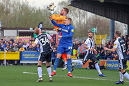 Gillingham goalkeeper Tomas Holy (1) beating AFC Wimbledon striker Joe Pigott (39) to the ball during the EFL Sky Bet League 1 match between AFC Wimbledon and Gillingham at the Cherry Red Records Stadium, Kingston, England on 23 March 2019.