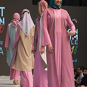Olympia London, UK. 21 April 2018: Designer showcases it latest design at the Modest Fashion Show at  London Muslim Lifestyle Show 2018, London, UK.