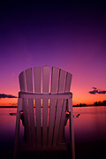 Muskoka chair on shore of Lake of the Woods<br />Sioux Narrows<br />Ontario<br />Canada