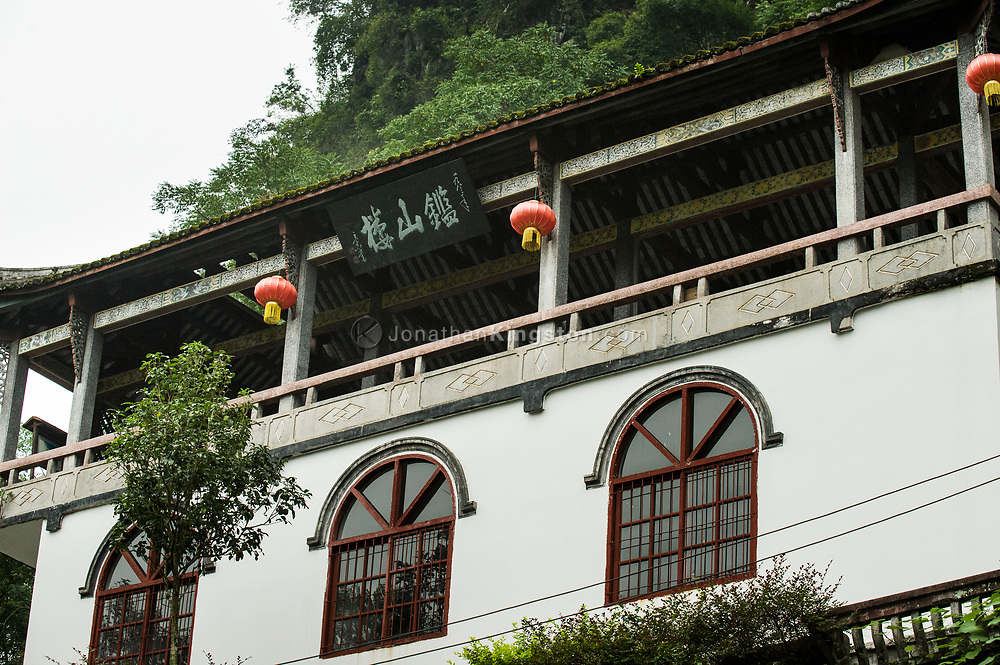 A white Asian style building with red laterns in Yangshuo, China.