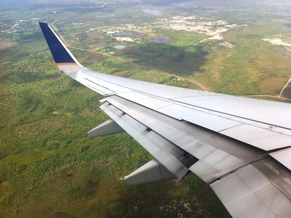 Belize City, Belize 8/31/2012.Descending into Belize City on United Airlines flight 1410..Alex Jones / www.alexjonesphoto.com