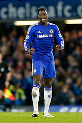 Kurt Zouma of Chelsea celebrates after Chelsea win 1-0 (2-1 on aggregate) after extra time to progress to the Final - Photo mandatory by-line: Rogan Thomson/JMP - 07966 386802 - 27/01/2015 - SPORT - FOOTBALL - London, England - Stamford Bridge - Chelsea v Liverpool - Capital One Cup Semi-Final Second Leg.