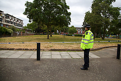 © Licensed to London News Pictures. 06/06/2020. London, UK. A police officer guards the crime scene on Brackenfield Close, Hackney in East London as police launch an investigation following a fatal shooting. Police were called at 11.30 pm on Friday 5 June, to reports of shots fired in Brackenfield Close and found a man in his twenties suffering gunshot injuries. Despite the efforts of medics and officers, the man was pronounced dead at the scene. Photo credit: Dinendra Haria/LNP
