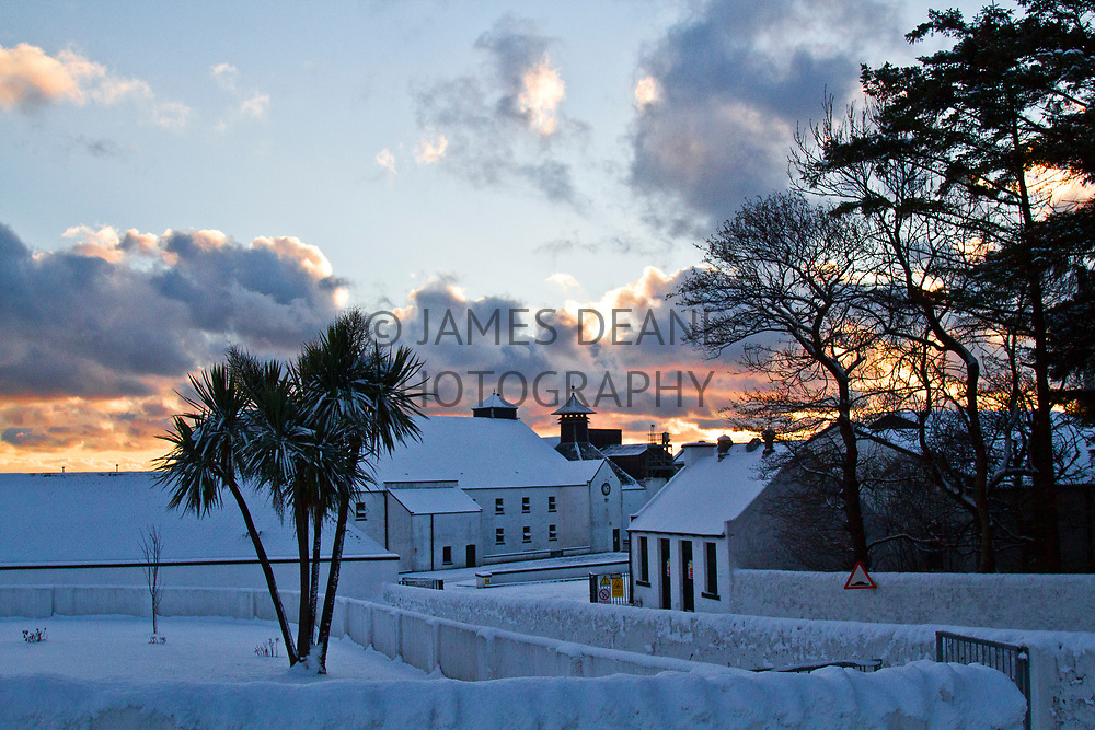 Laphroaig Distillery on the Isle of Islay covered in Winter snow