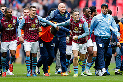 Ashley Westwood, Jack Grealish and other players celebrate after Aston Villa win the match 2-1 to reach the 2015 FA Cup Final - Photo mandatory by-line: Rogan Thomson/JMP - 07966 386802 - 19/04/2015 - SPORT - FOOTBALL - London, England - Wembley Stadium - Aston Villa v Liverpool - FA Cup Semi Final.
