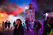 Shangri La is a festival of contemporary performing arts held each year within Glastonbury Festival. The theme for the 2015 Shangri La was Protest. People arrive into the Hell stage area of the Shangri La field.