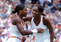 Sisters Serena and Venus Williams hug at the end of their final. Wimbledon Tennis Championship, Day 12, 5/07/2003. Credit: Colorsport / Matthew Impey DIGITAL FILE ONLY