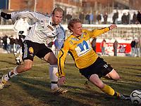 Fotball eliteserien 16.03.2006 Rosenborg - Start 2-0<br /> Mikael Dorsin, RBK og Jon Midttun Lie, Start<br /> Foto: Carl-Erik Eriksson, Digitalsport