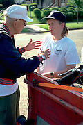 Senior Boy Scout leader organizing camping trip ages 80 and 17.  St Paul  Minnesota USA