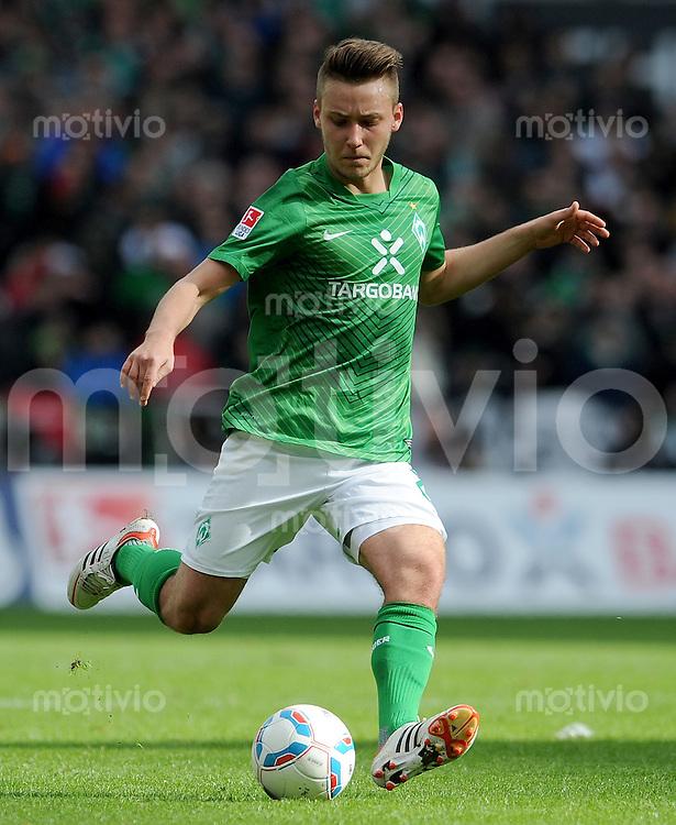 FUSSBALL   1. BUNDESLIGA   SAISON 2011/2012   28. SPIELTAG SV Werder Bremen - FSV Mainz 05                        31.03.2012 Tom Trybull (SV Werder Bremen) Einzelaktion am Ball