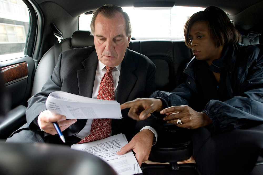 Chicago Mayor Richard Daley rides to a public announcement of the HuaMei Capital Company, the first American financial services company owned jointly with a Chinese company, along with Press Secretary Jacquelyn Heard.  HuaMei will be headquartered in Chicago.
