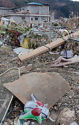 A child's mask depicting a Kamen Rider superhero is deposited in the debris after the tsunami in Ofunato, Iwate, Japan. March 17th 2011
