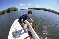 Colin Eimers Putting Oyster Tray Back Into The Sasanoa River