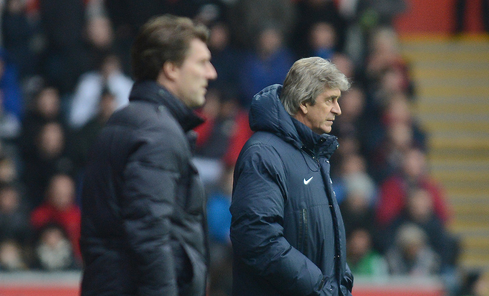 Manchester City's Manager Manuel Pellegrini looks on during the game <br /> <br /> Photo by Ian Cook/CameraSport<br /> <br /> Football - Barclays Premiership - Swansea City v Manchester City - Wednesday 1st January 2014 - Liberty Stadium - Swansea<br /> <br /> © CameraSport - 43 Linden Ave. Countesthorpe. Leicester. England. LE8 5PG - Tel: +44 (0) 116 277 4147 - admin@camerasport.com - www.camerasport.com