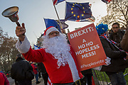 Anti-Brexit activists protest outside the Houses of Parliament on the 11th December 2018 in central London in the United Kingdom. Pro-Brexit and Anti Brexit campaigners congregate on the day of the proposed Brexit vote.