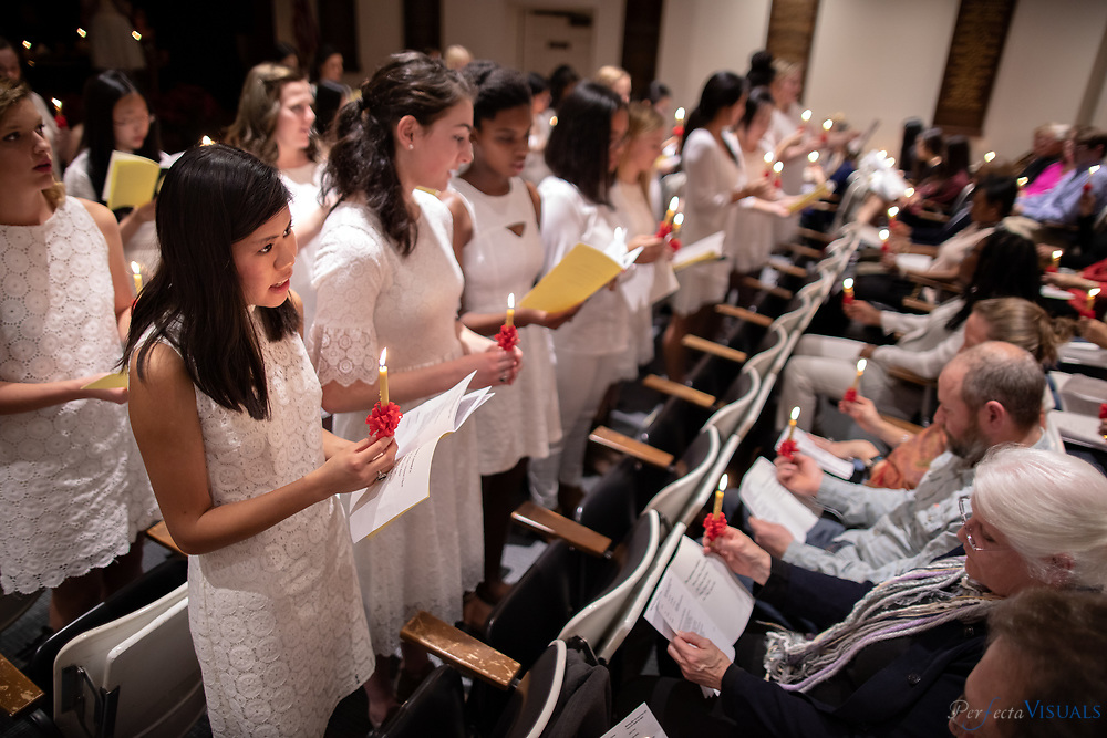 Salem Academy - Senior Vespers<br /> <br /> Salem Academy student Abbey Linnell, foreground, sings during senior vespers.<br /> <br /> Photographed, Sunday, December 3, 2017, in Greensboro, N.C. JERRY WOLFORD and SCOTT MUTHERSBAUGH / Perfecta Visuals