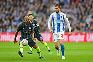 Manchester City midfielder Fernandinho (25) and Brighton & Hove Albion midfielder Davy Propper (24) during the The FA Cup semi-final match between Manchester City and Brighton and Hove Albion at Wembley Stadium, London, England on 6 April 2019.