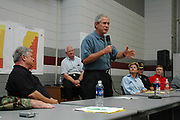 President Bush joins Governor of Mississippi Haley Barbou,left seated, at Pearl River Community College in Poplarville,Ms Monday Sept. 5,2005. Gathered atthe colleg are elected official from around the stae of Mississippi and law emforcement personnel affected Katrina. They are all ther for answers and help.Hurricane Katrina is the worst natural disaster to hit American soil and the National and local goverments are working together to clean up the mess from the catasrophic destruction. (Governors Office/Suzi Altman)