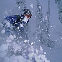"SKIING. Todd Scott (MR) skis thru ""snow ghosts"" at The Big Mountain Ski Area, Whitefish, MT."
