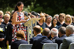 Hyde Park, London, July 7th 2015. Families of the victims and survivors of the 7/7 bombings in London gather at Hyde Park and are joined by the Duke of Cambridge Prince William at an emotional service commemorqating the Islamist terrorist bombing outrage that happened on London's transport network, claiming 57 lives and left scores of people injured. PICTURED:  Tracy Russel addresses the crowd