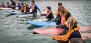 Friends and family celebrate the life of Brad Parker (36), during a paddle out memorial service at the Russian River Mouth near Jenner, California. An avid surfer and rock climber, Brad was killed in a fall while traversing Matthes Crest in Yosemite National Park on August 16, 2014, just hours after proposing to his girlfriend, Jainee Dial, on the summit of Cathedral Peak.