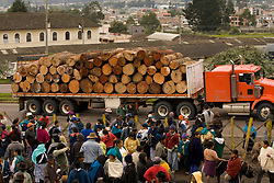 South America, Ecuador, Otavalo,  logging truck driving by weekly animal market