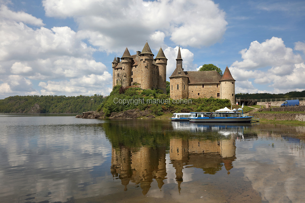 Chateau de Val, a 13th century medieval castle rebuilt several times until the 17th century, and the Chapelle Saint-Blaise, built 15th century, in Lanobre, Cantal, Correze, Artense, Auvergne-Rhone-Alpes, France. The castle is now surrounded by a lake created by the building of the dam Barrage de Bort les Orgues, built 1942-52. The building is listed as a historic monument. Picture by Manuel Cohen