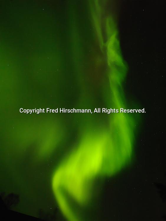 Green aurora over Fred and Randi Hirschmann's home along Cottonwood Creek, October 13, 2013, Matanuska Valley, Alaska.