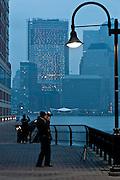 USA, NY, New York City, Manhattan The Hudson River at sunrise a photographer at work