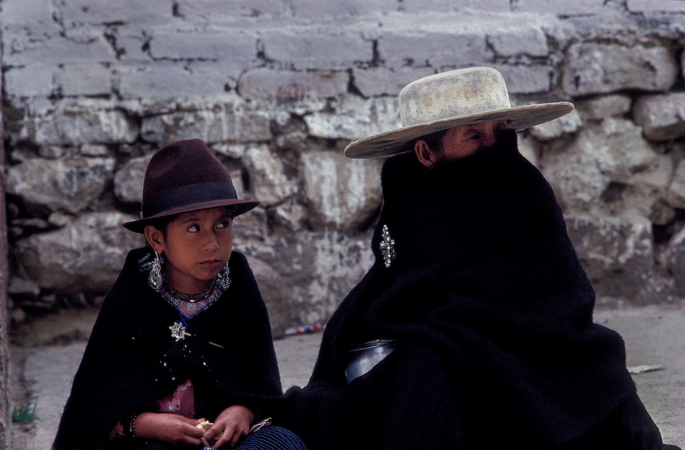 Saraguro Indians wear black - in mourning for their lost Inca king Atahualpa - outside church on Sunday.