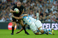 Tony Woodcock of New Zealand is tackled by Pablo Matera of Argentina and Mariano Galarza of Argentina. Rugby World Cup 2015 pool C match, New Zealand v Argentina at Wembley Stadium in London on Sunday 20th September 2015.<br /> pic by John Patrick Fletcher, Andrew Orchard sports photography.