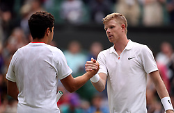 Kyle Edmund (right) and Jaume Munar shake hands after their match on day one of the Wimbledon Championships at the All England Lawn Tennis and Croquet Club, Wimbledon.