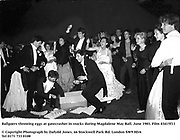 Ballgoers throwing eggs at gatecrasher in stocks during Magdalene May Ball. June 1983. Film 83415f11<br />© Copyright Photograph by Dafydd Jones<br />66 Stockwell Park Rd. London SW9 0DA<br />Tel 0171 733 0108