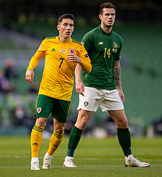 DUBLIN, REPUBLIC OF IRELAND - Sunday, October 11, 2020: Wales' Harry Wilson (L) and Republic of Ireland's Kevin Long during the UEFA Nations League Group Stage League B Group 4 match between Republic of Ireland and Wales at the Aviva Stadium. The game ended in a 0-0 draw. (Pic by David Rawcliffe/Propaganda)