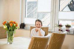 Portrait of smiling boy sitting at table