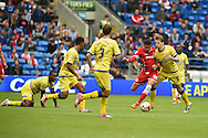Ravel Morrison of Cardiff city (2nd right) looks for a way through the Sheff Wed defence. Skybet football league championship match, Cardiff city v Sheffield Wed at the Cardiff city stadium in Cardiff, South Wales on Saturday 27th Sept 2014<br /> pic by Andrew Orchard, Andrew Orchard sports photography.