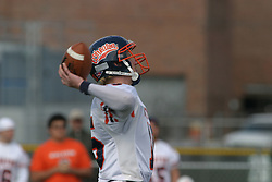 22 October 2005: Thunder QB Jeremy Chupp unloads a pass. The Illinois Wesleyan Titans posted a 23 - 14 home win by squeeking past the Thunder of Wheaton College at Wilder Field (the 5th oldest collegiate field in the US) on the campus of Illinois Wesleyan University in Bloomington IL
