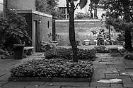 Man sitting in a church garden near the Metropolitan Museum in Manhattan
