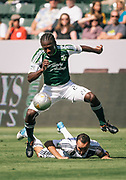 Portland Timbers midfielder Diego Chara, top, wins the ball from Los Angeles Galaxy midfielder Landon Donovan during the first half of an MLS soccer match, Sunday, June 17, 2012, in Carson, Calif. (AP Photo/Bret Hartman)